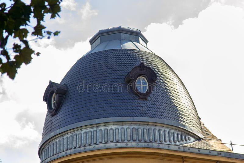 Domed top of the old building, tiled roof stock photos