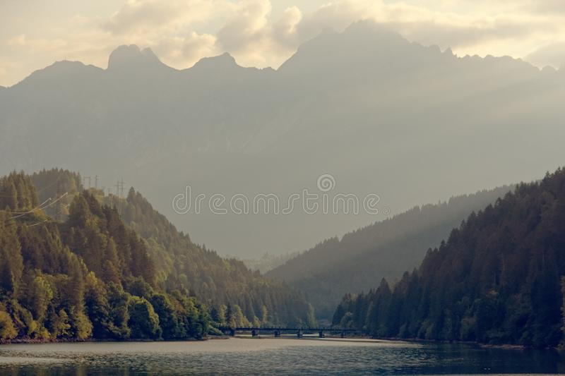 Domegio di Cadore, Italy Beautiful lake in the mountains at sunrise.  stock photos