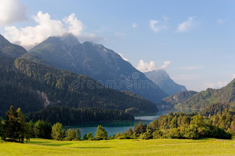 Domegio di Cadore, Italy Beautiful lake in the mountains at sunrise.  royalty free stock photography