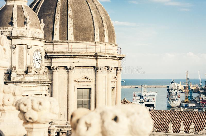 Domes of the Cathedral dedicated to Saint Agatha. The view of the city of Catania, Sicily, Italy.  stock photography