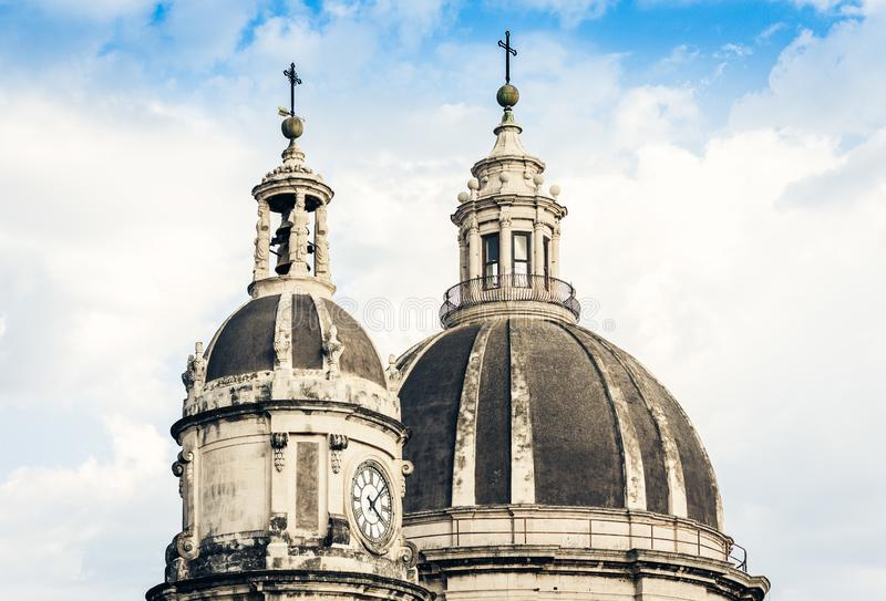 Domes of the Cathedral dedicated to Saint Agatha. The view of the city of Catania, Sicily, Italy.  royalty free stock images