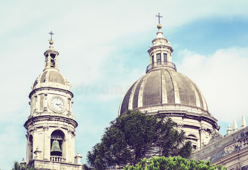 Domes of the Cathedral dedicated to Saint Agatha. The view of the city of Catania, Sicily, Italy.  stock photos