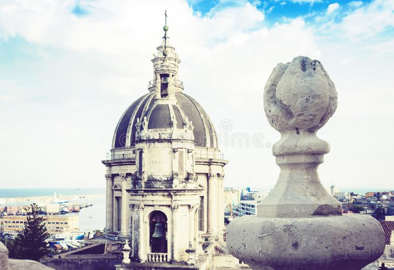 Domes of the Cathedral dedicated to Saint Agatha. The view of the city of Catania, Sicily, Italy.  stock photo
