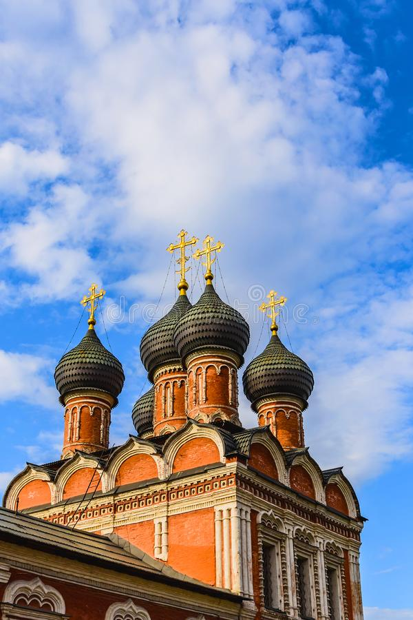 Domes of the Cathedral in the name of the icon of the Mother of God `Bogolyubskaya` 1684. Vysoko-Petrovsky Monastery. Moscow. stock photography