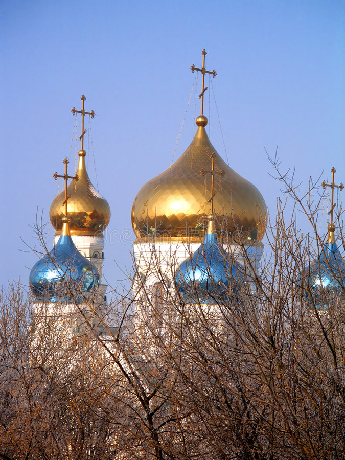 Domes of church. The golden and blue domes with crosses of the orthodox church stock photography