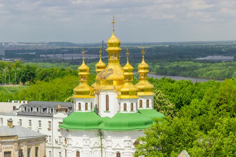 Church of All Saints in the Kyiv Pechersk Lavra, Ukraine. Domes of the Church of All Saints over the Economic Gate 17th century of Kyiv Pechersk Lavra. View from royalty free stock image