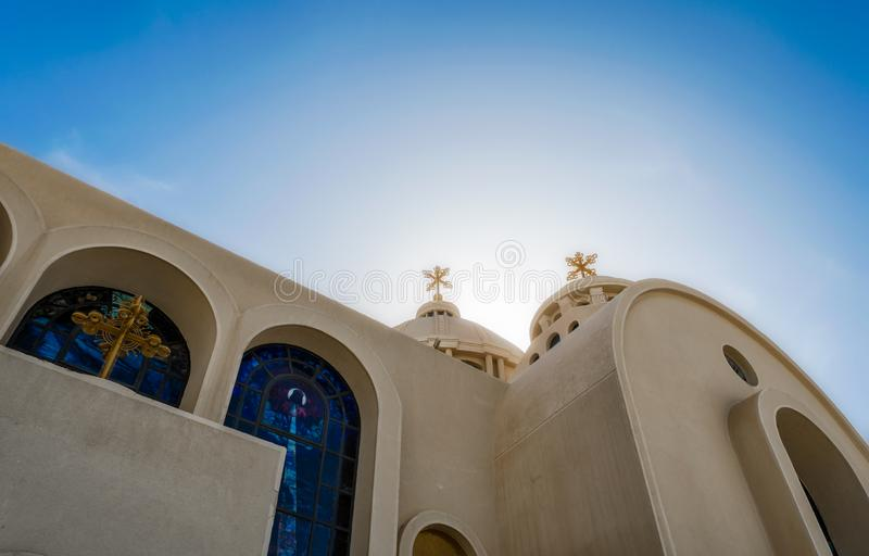 Domes and crosses of a Christian church against the blue sky in Egypt. In Sharm el Sheikh royalty free stock photography