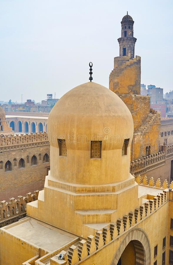 Domes and minarets of Cairo, Egypt. The fine examples of interesting medieval architecture of Cairo - the dome and carved wall of Amir Sarghatmish mosque and the royalty free stock photography