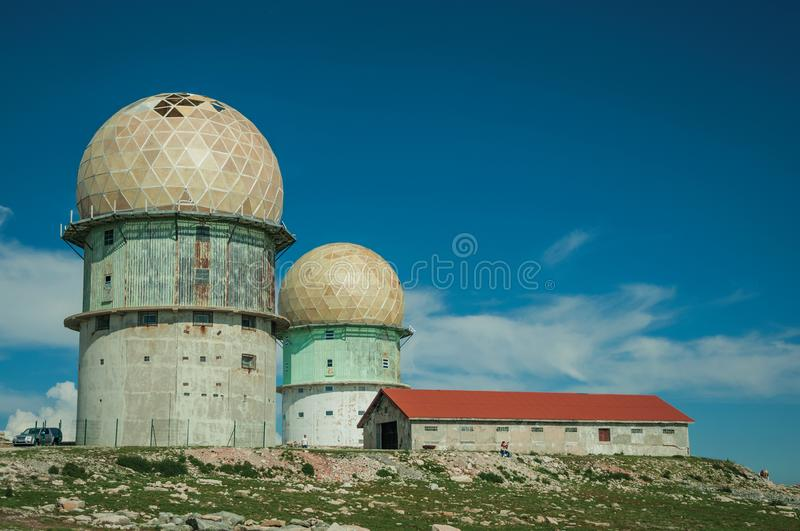Domes of old radar station and house on rocky place. Domes of an old radar station and house on a rocky place called Torre, in the highest point of the Serra da stock photos