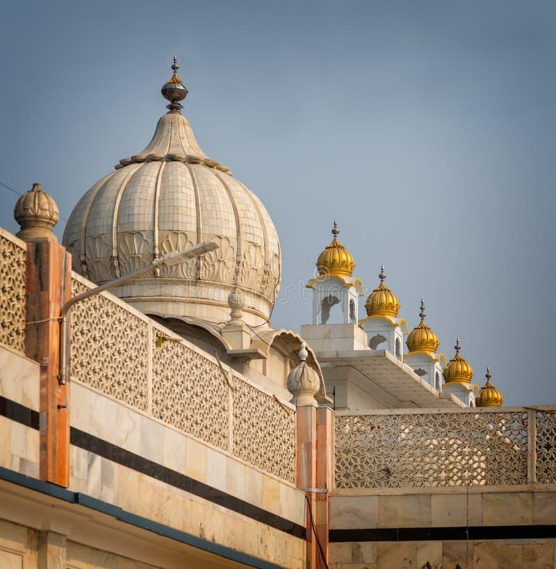 Domes of Sikh Temple glisten in sunshine in Delhi .tif. Domes of Sikh Temple glisten in sunshine in New Delhi, India stock image