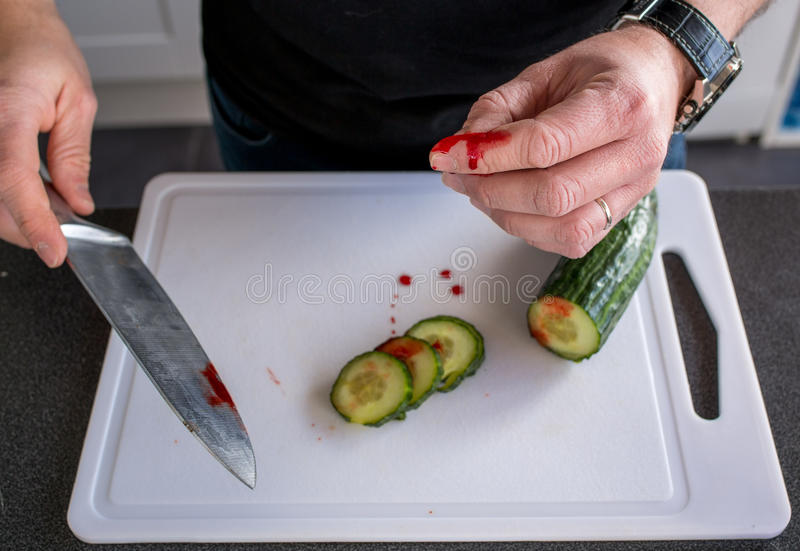 Domestic accident with a knife. Wounded with a knife in the kitchen - domestic accident royalty free stock images