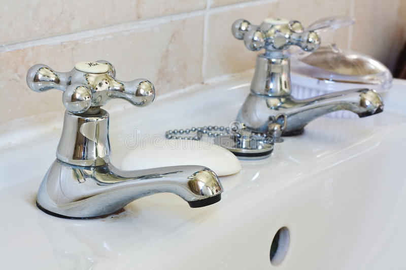 Domestic bathroom taps royalty free stock images