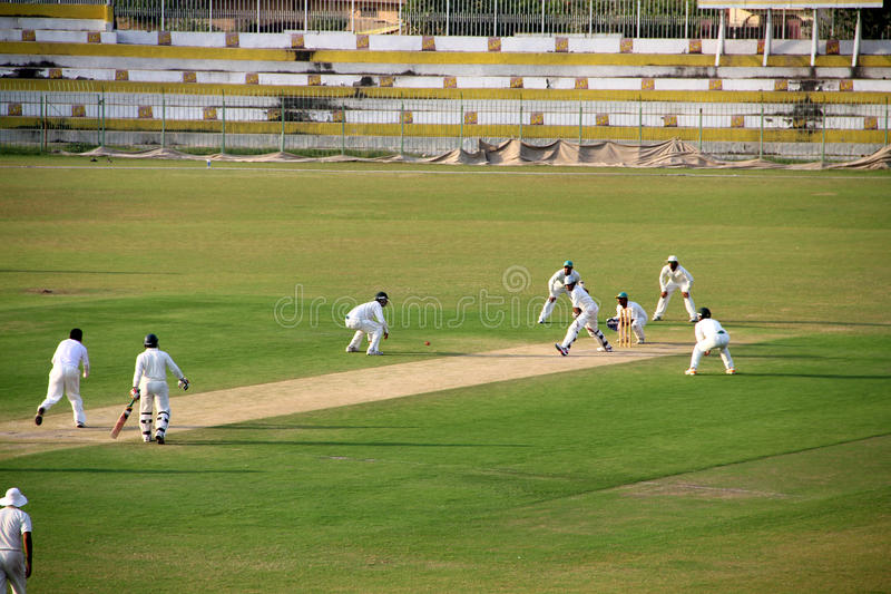 Domestic Cricket Match. SIALKOT, PAKISTAN - OCTOBER 08: Danish Kaneria bowling during Quaid-e-Azam Trophy Cricket Match Played Between Sialkot and HBL Teams at stock photo
