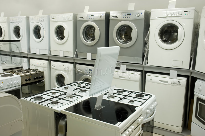 Domestic eqiupment in the stor. Domestic equipment (washing machines and gas stoves) arranged in the store stock images
