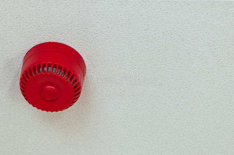Domestic fire alarm sound alert red round ceiling. Above stock image