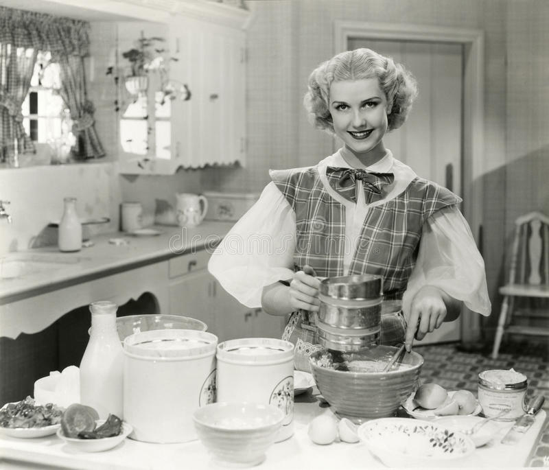 Domestic goddess baking in the kitchen stock image