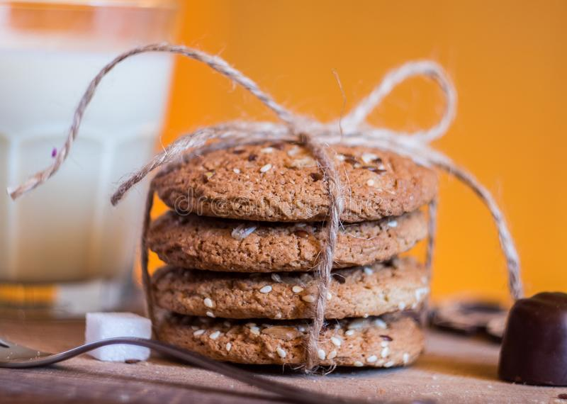 Homemade fresh oats cookies with sesame and milk stock photos
