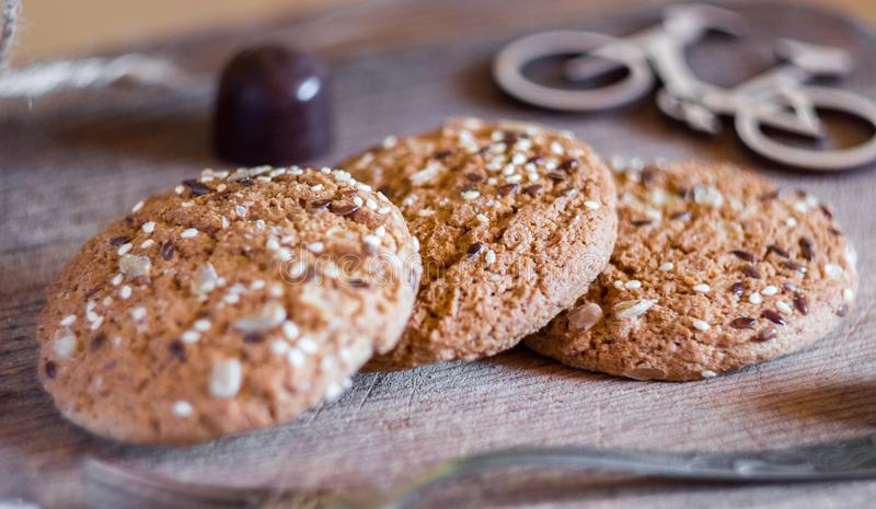 Homemade fresh oats cookies with sesame and milk stock photography