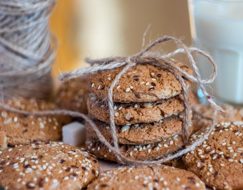 Homemade fresh oats cookies with sesame and milk stock images
