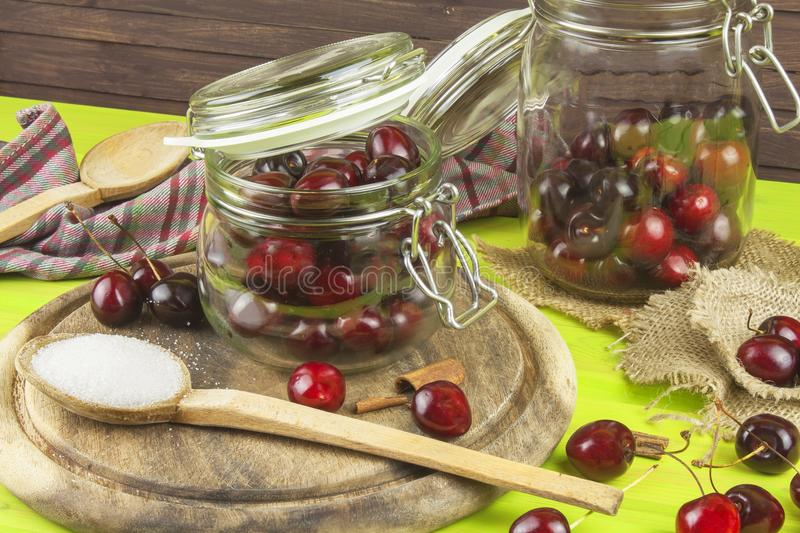 Domestic production of cherry jam. Freshly picked cherries ready for canning. The supply of fruits for the winter and a rainy day. The preparation of sweets royalty free stock photo