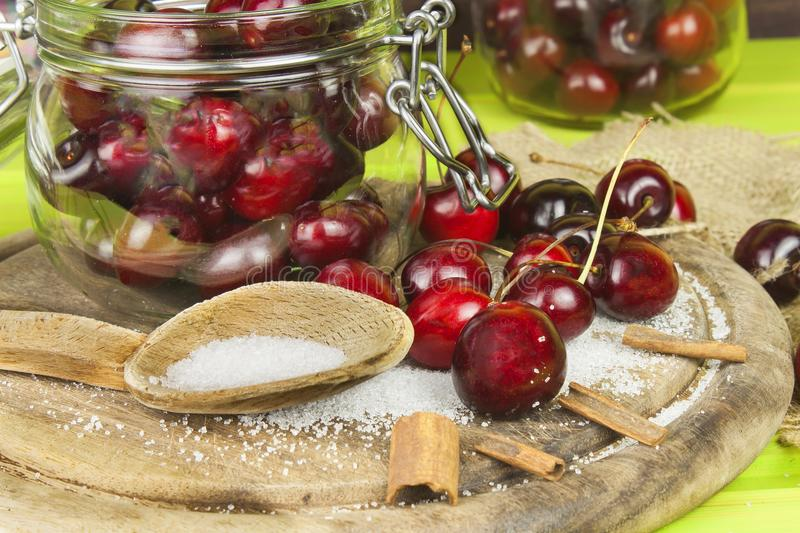 Domestic production of cherry jam. Freshly picked cherries ready for canning. The supply of fruits for the winter and a rainy day. The preparation of sweets royalty free stock images