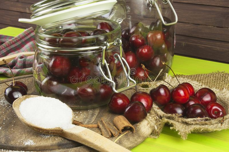 Domestic production of cherry jam. Freshly picked cherries ready for canning. The supply of fruits for the winter and a rainy day. The preparation of sweets stock images