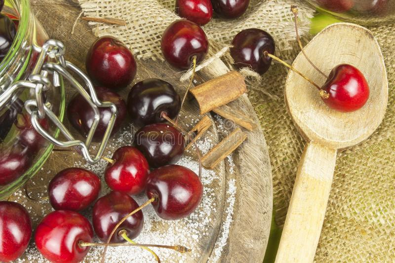 Domestic production of cherry jam. Freshly picked cherries ready for canning. The supply of fruits for the winter and a rainy day. The preparation of sweets royalty free stock image