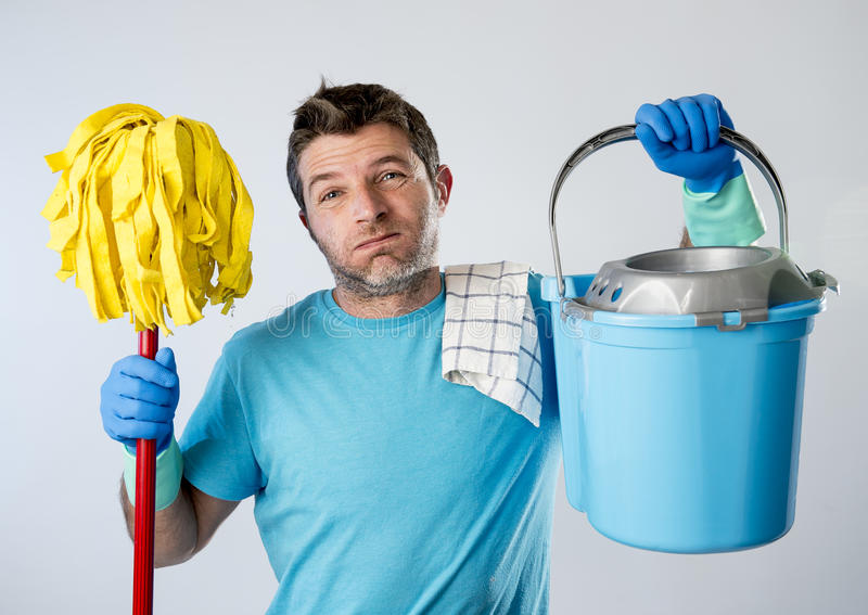 Domestic service man or stressed husband housework washing holding mop and bucket royalty free stock photo