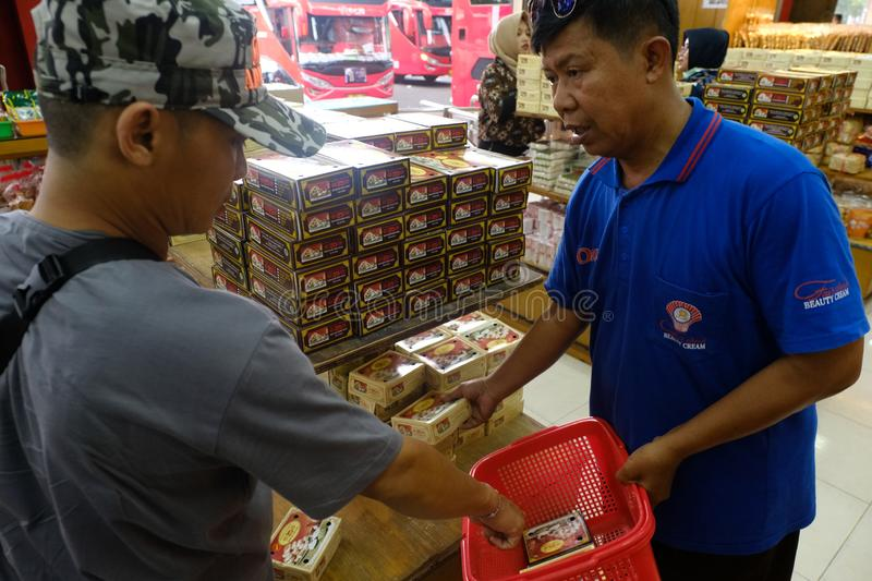 Domestic tourists shopping at center of culinary. Yogyakarta-Indonesia, 13/04/2019: Domestic tourists are shopping at the center of food items such as bakpia and stock image