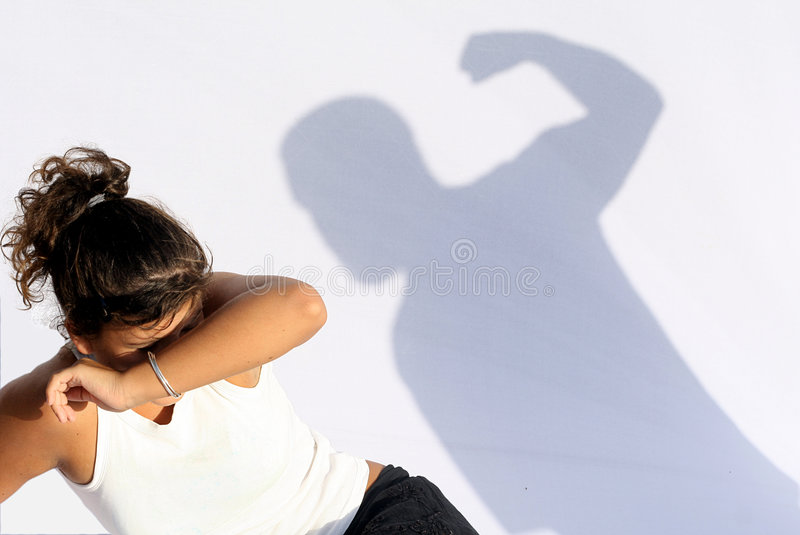 Domestic violence abuse. Scared child or woman afraid of domestic violence abuse royalty free stock photography