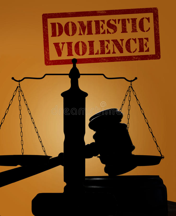 Domestic Violence and gavel with scales. Court gavel and scales of justice silhouette with Domestic Violence text stock photography