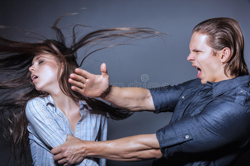 Domestic violence. Woman victim of domestic violence and abuse. Husband beats his wife stock photos