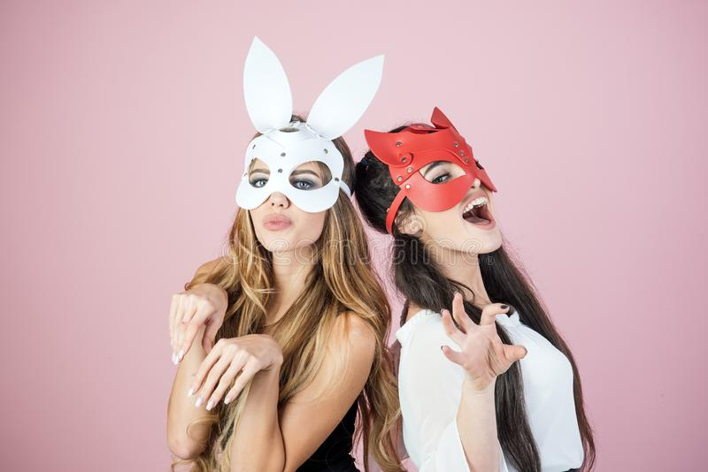 Dominant, mistress, bdsm, erotic rabbit mask. Dominant lesbian women love relationship superhero stock photos