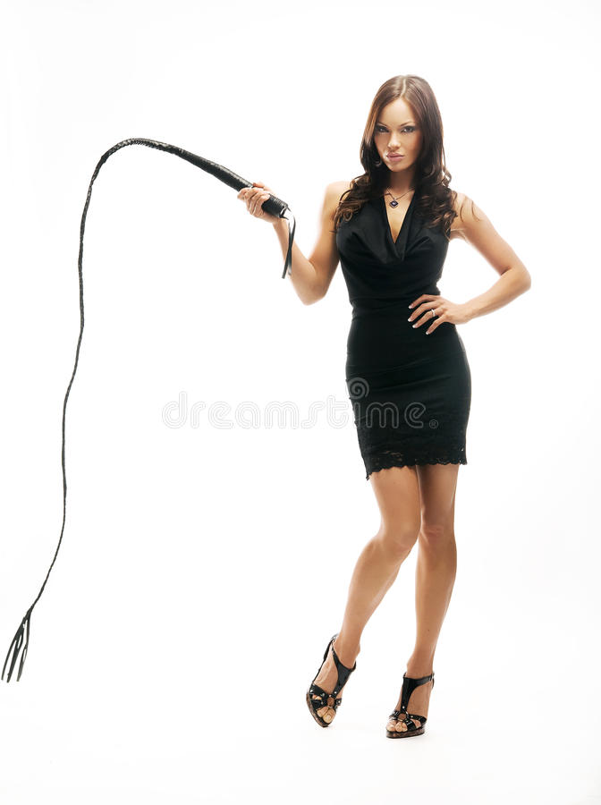 Cruel lady with whip trains slave