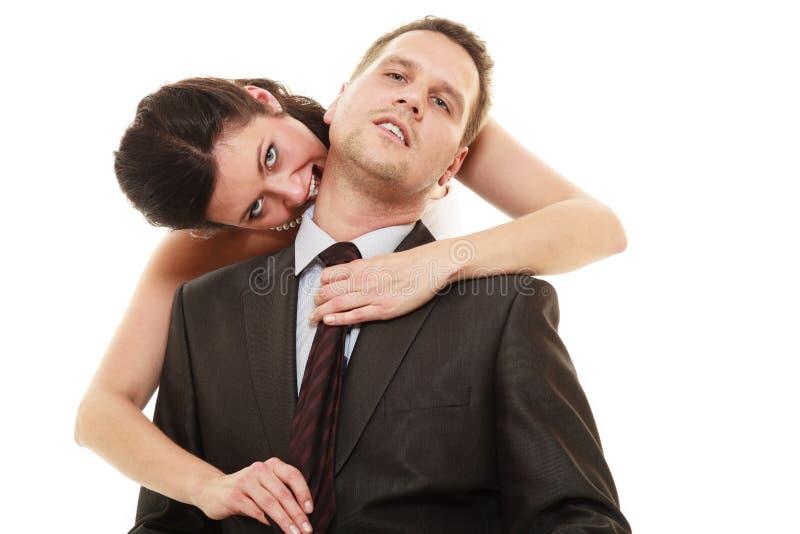 Dominante bruid met echtgenoot stock foto's