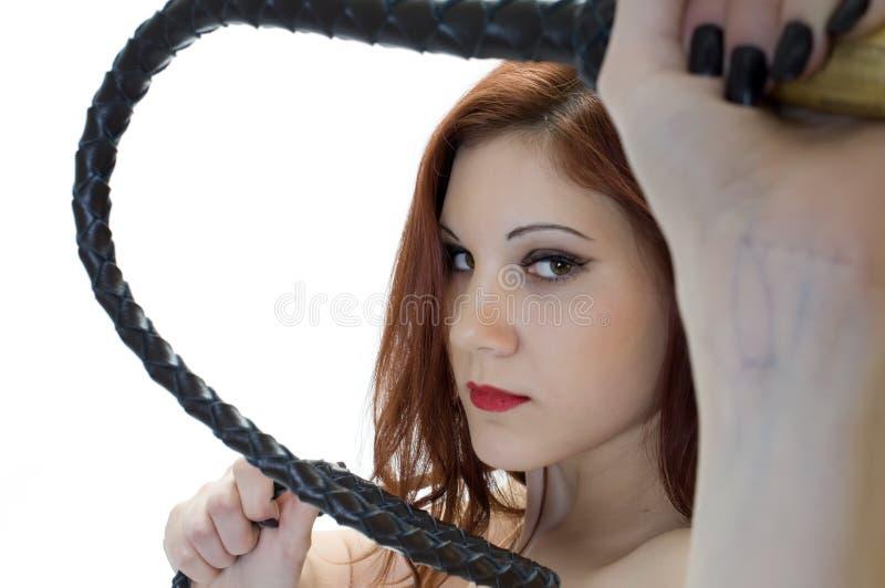 dominatrix纵向鞭子 免版税图库摄影