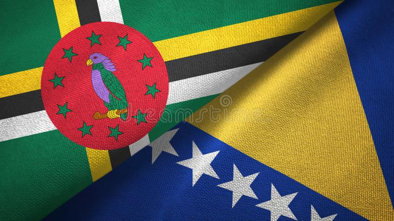 Dominica and Bosnia and Herzegovina two flags textile cloth, fabric texture. Dominica and Bosnia and Herzegovina flags together textile cloth, fabric texture stock images