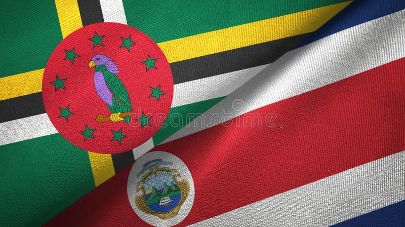Dominica and Costa Rica two flags textile cloth, fabric texture royalty free illustration
