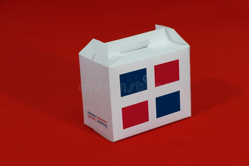 Dominican flag on white box with barcode and the color of nation flag on red background. The concept of export trading from. Dominican, paper packaging for put royalty free stock photos