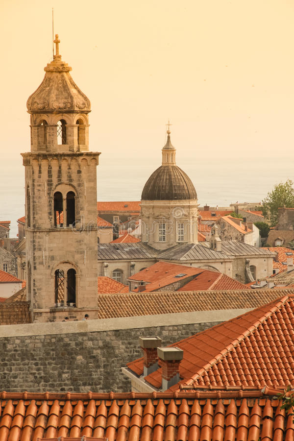 Dominican monastery bell tower. Dubrovnik. Croatia. Rooftops, the Dominican monastery bell tower and the cathedral dome at sunset. Dubrovnik. Croatia royalty free stock images