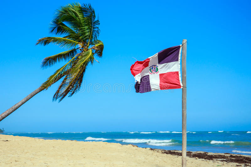 Dominican Republic flag. On the beach stock photography