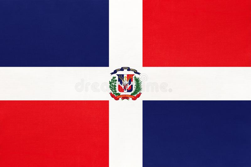 Dominican republic national fabric flag textile background. Symbol of world north America country. Dominican republic national fabric flag textile background stock image