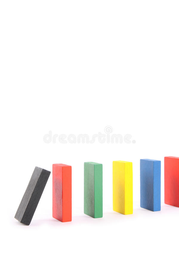 Domino. An imminent collapse of domino, as well as to suggest that some of the chain reaction is imminent royalty free stock photography