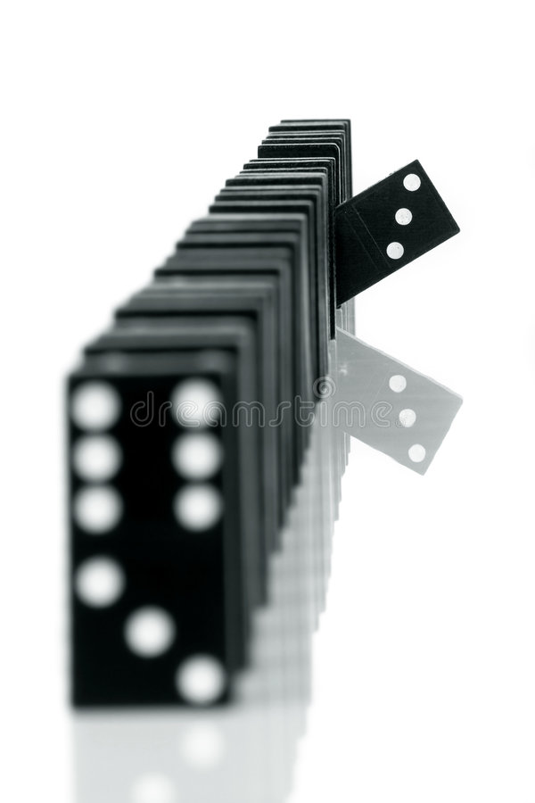 Domino 6. One domino being different than the others, isolated on white background royalty free stock photography