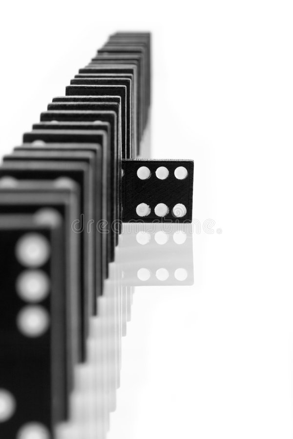 Domino 7. One domino being different than the others, isolated on white background stock photo