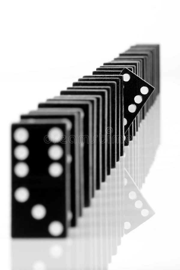 Domino 8. One domino being different than the others, isolated on white background stock images