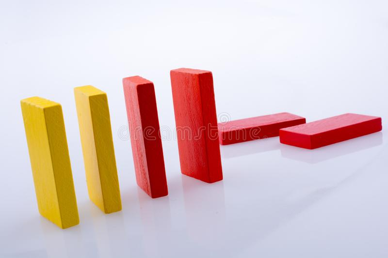 Domino Blocks of various color. Colorful Domino Blocks in a line on a white background stock photo