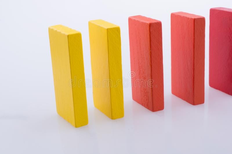 Domino Blocks of various color. Colorful Domino Blocks in a line on a white background royalty free stock photography