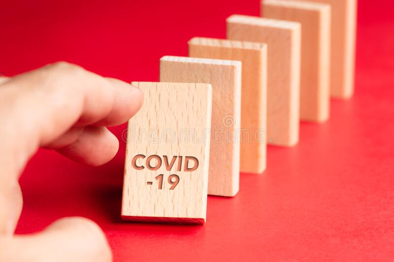 Domino Consequences of Covid-19 royalty free stock photography