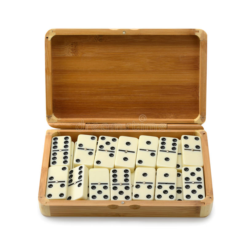 Domino dans la boîte images stock